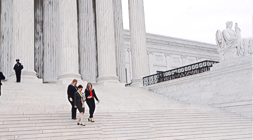 two people walking down the white marble steps of the Supreme Court building